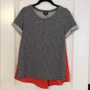 Women's grey blouse with red statement back